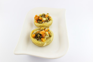 Stuffed artichoke on white porcelain plate