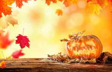 Scary hallowen pumpkin on wood