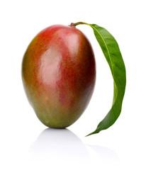 Studio shot of one whole mango with leaf isolated