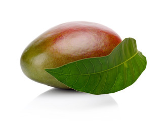 Studio shot of one whole mango with leaf isolated