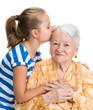 Granddaughter kissing her old grandmother