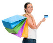 Happy young woman holding shopping bags and credit card