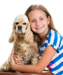 Pretty smiling girl with american spaniel