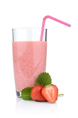 Several sliced strawberries with leaf,juice and straw isolated