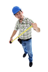 Construction worker taking a measure