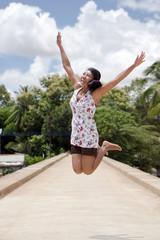 Girl jumping on the bridge