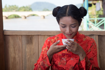 Asian girl holding drink