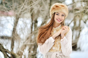 Portrait of smiling young woman in winter outdoors