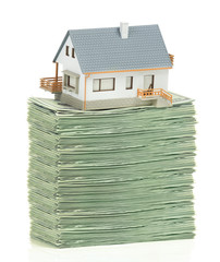 House and stack of dollars
