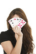 Pretty brunette young girl holding deck of cards