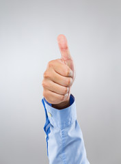 Businessman hand show with thumb up