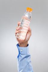 Businessman hold water bottle