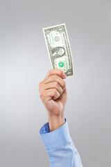 Businessman hand hold US dollar