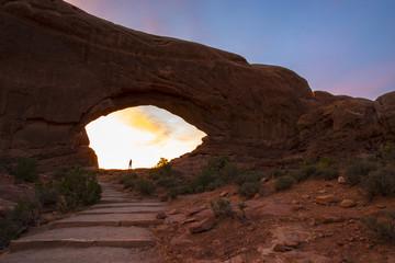 Famel hiker stading in North Window at sunrise