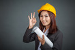 Asian engineer girl show OK sign and smile on gray background