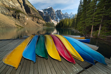 canoes by the mountain lake