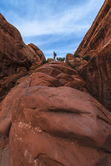 Female hiker on a Devils Garden trail to Double O Arch