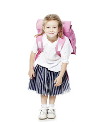the little girl smiles . white background with pink backpack