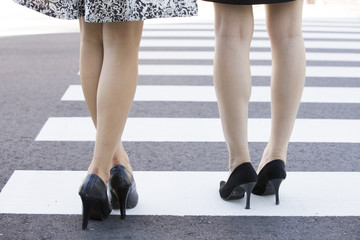 Young woman stand in a crosswalk