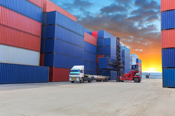 forklift handling the container box at dockyard with beautiful s