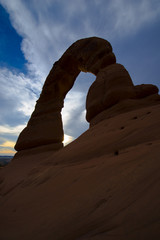 Beautiful sunset sky over Delicate Arch from below
