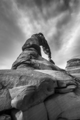 Black and white dramatic sky over Delicate Arch