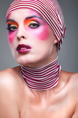 girl with a bright make-up with the striped scarf on a head