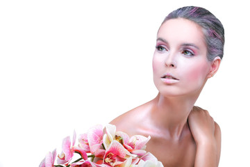 Beautiful girl, on white, with pink orchids, emotions, cosmetics