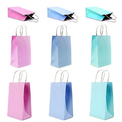 nine empty shopping paper bags in pastel colors.