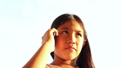 Little girl speaks on mobile phone