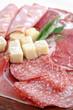 Mix  italian antipasto with prosciutto and parmigiano