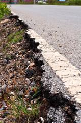 Damaged asphalt road, bad road