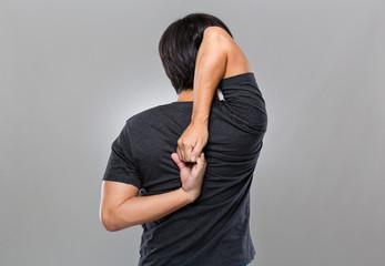 Man stretching arm behind back