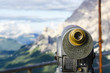 A binoculars with a wonderful view of a Dolomites Mountains - 69070172
