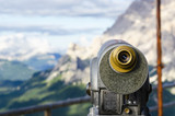 A binoculars with a wonderful view of a Dolomites Mountains