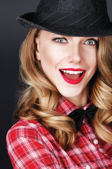 bright beautiful girl in a hat