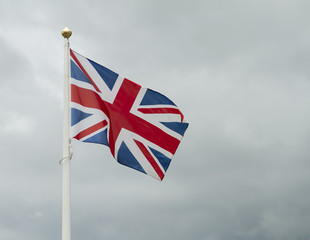 Great britain flag against stormy sky