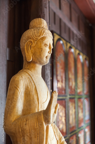 Leinwandbild Motiv Wooden Buddha Statue Inside Chainese Temple