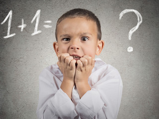 Portrait confused, anxious boy trying to solve math problem
