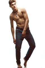 Male beauty & Blue jeans concept. Handsome male model in jeans