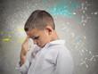 Genius boy solving science problem, background with formulas