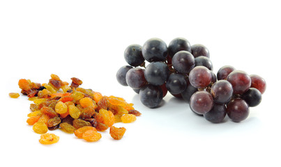 Grapes with raisins isolated on white background