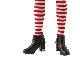Lower half of girl wearing stripey socks and boots