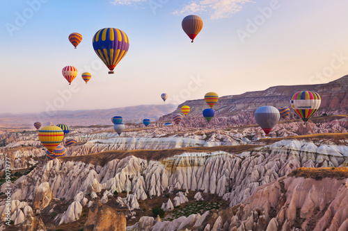Leinwanddruck Bild Hot air balloon flying over Cappadocia Turkey
