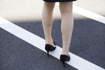 Legs of a woman wearing high heels