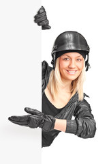 Female biker pointing on a panel with her hand