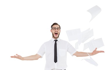 Nerdy businessman with papers flying