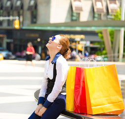 Happy, young  shopping woman in Manhattan NYC