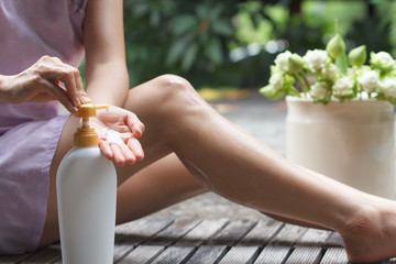 Women exposed skin with lotion