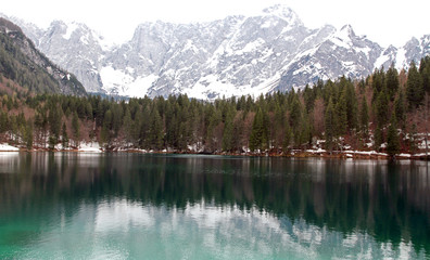 Lake of Fusine with the snowy Alps in the background